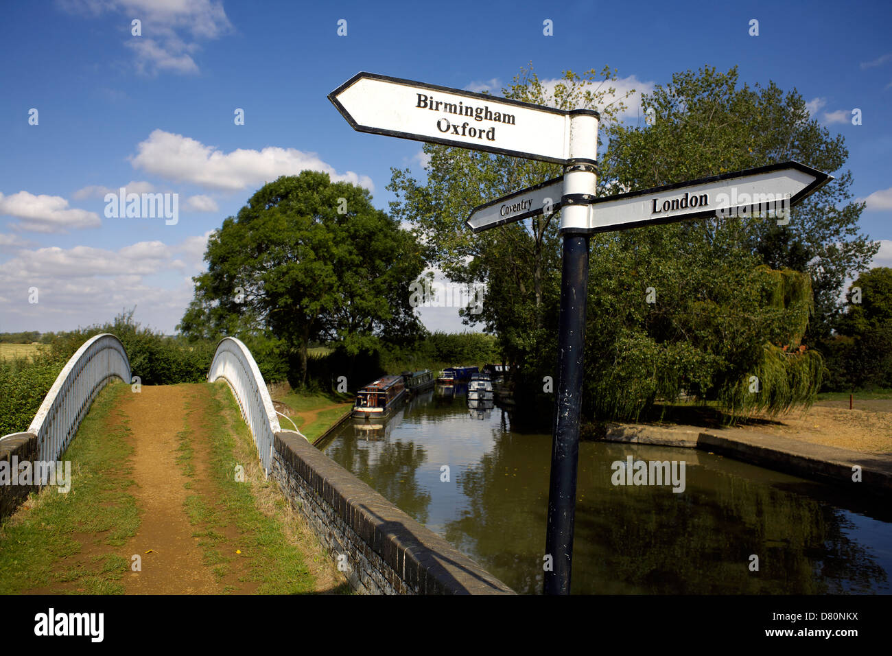 Canal signpost at the junction between the Oxford Canal and the Grand Union Canal Boats on the Oxford Canal Braunston - Stock Image