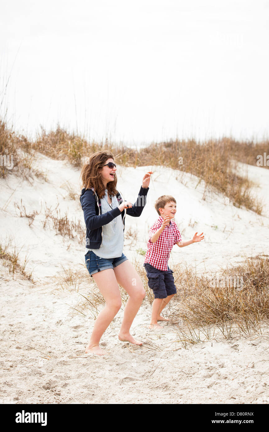 Sister and Brother playing catch - Stock Image