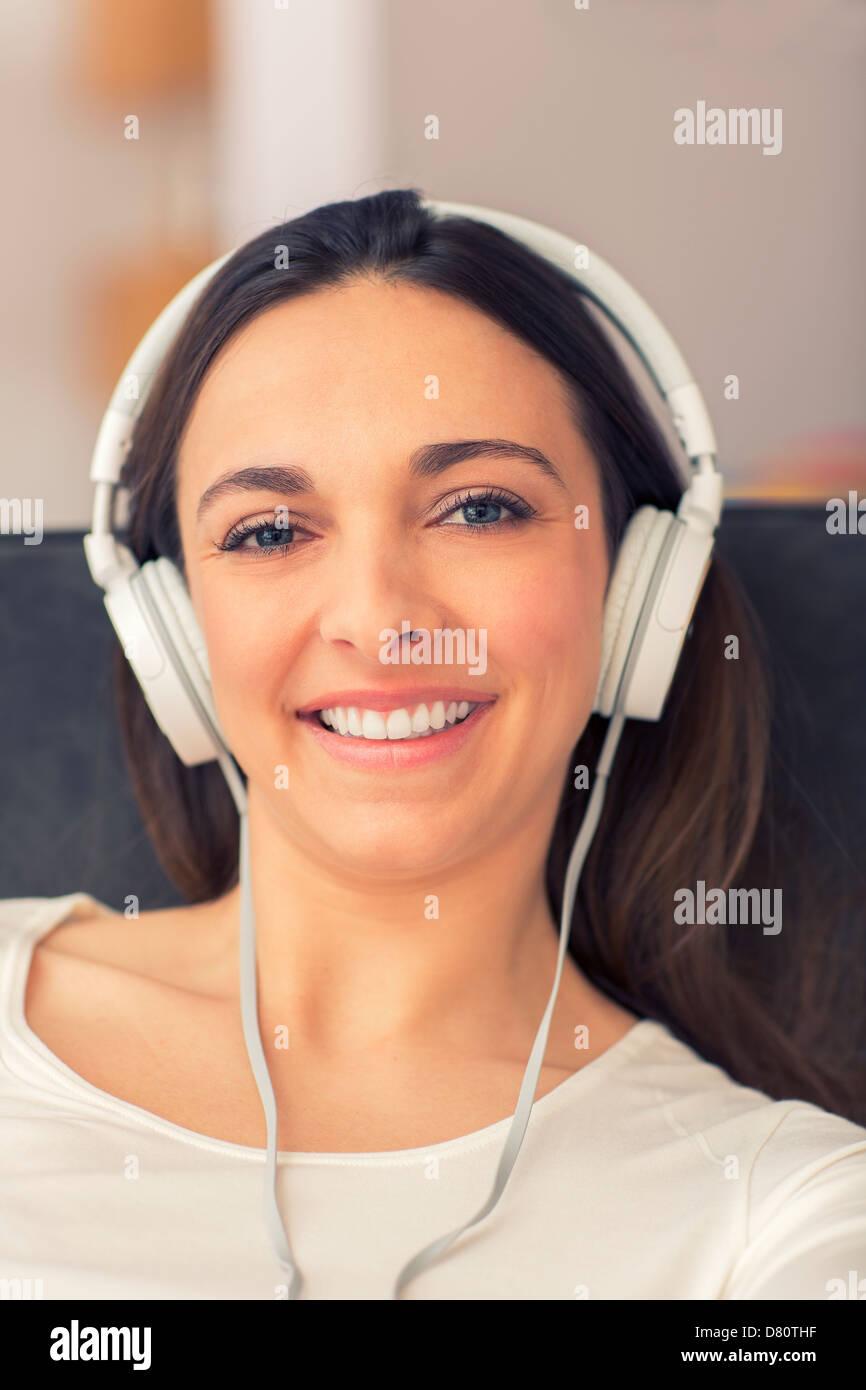 Portrait of simling female whit her headphones - Stock Image