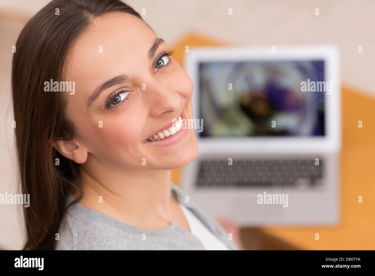 Female looking at pictures on her computer - Stock Image