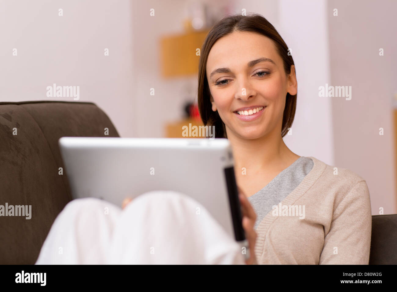 female consults email on pad - Stock Image