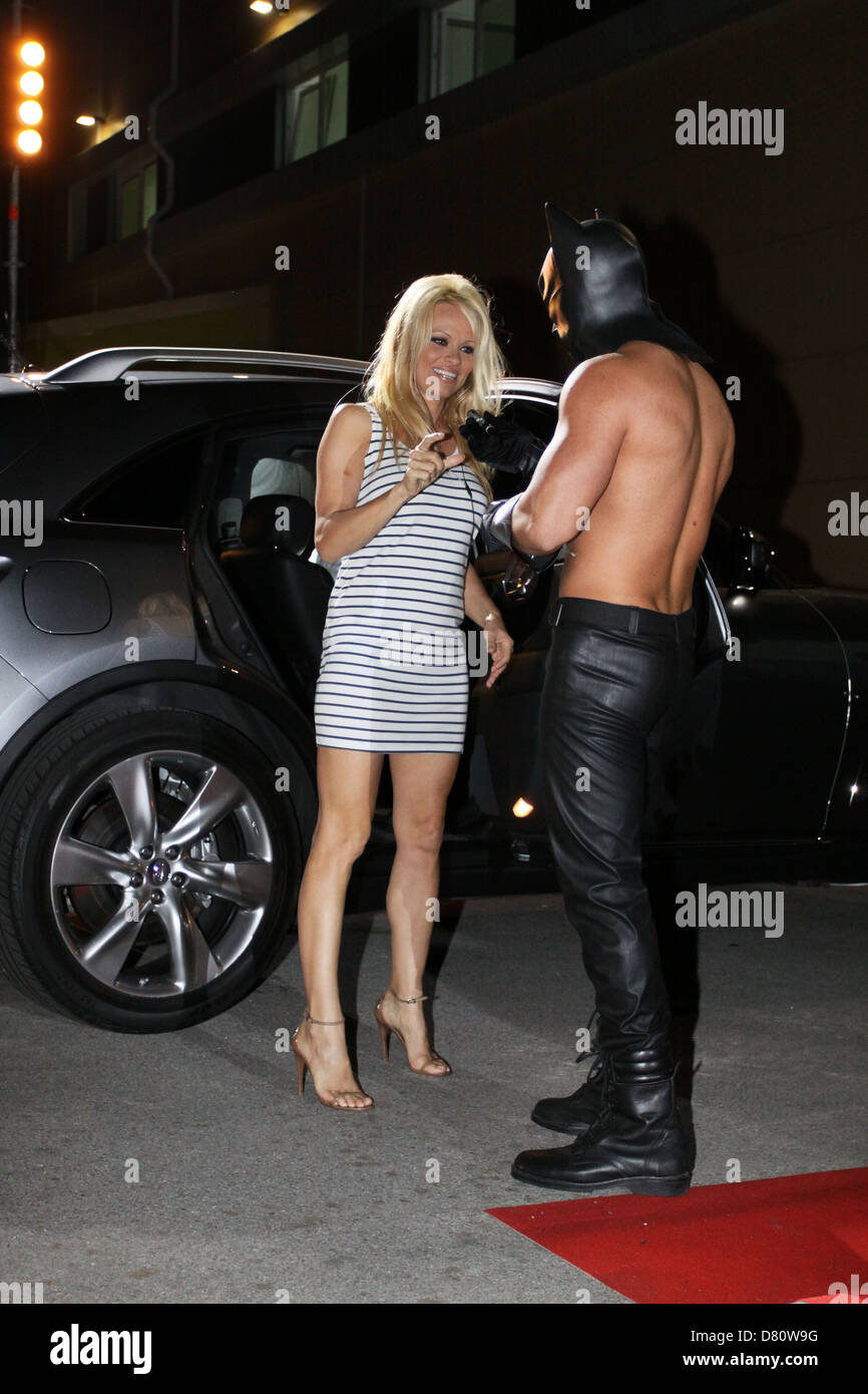 Pamela Anderson was in Bulgaria to participate in a Big Brother show. Here she arrives at the house of Big Brother. - Stock Image