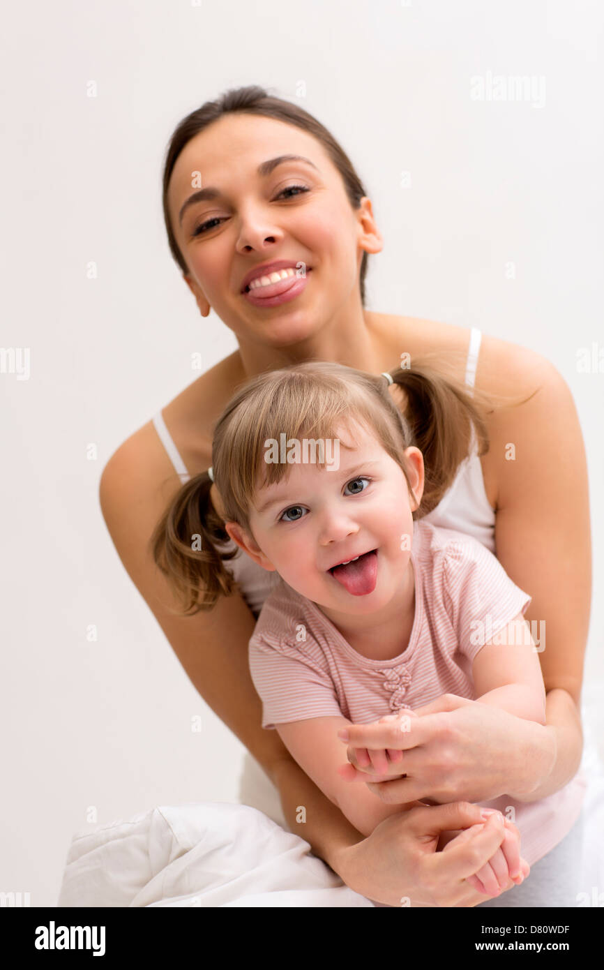Portrait of a family at home in bedroom - Stock Image