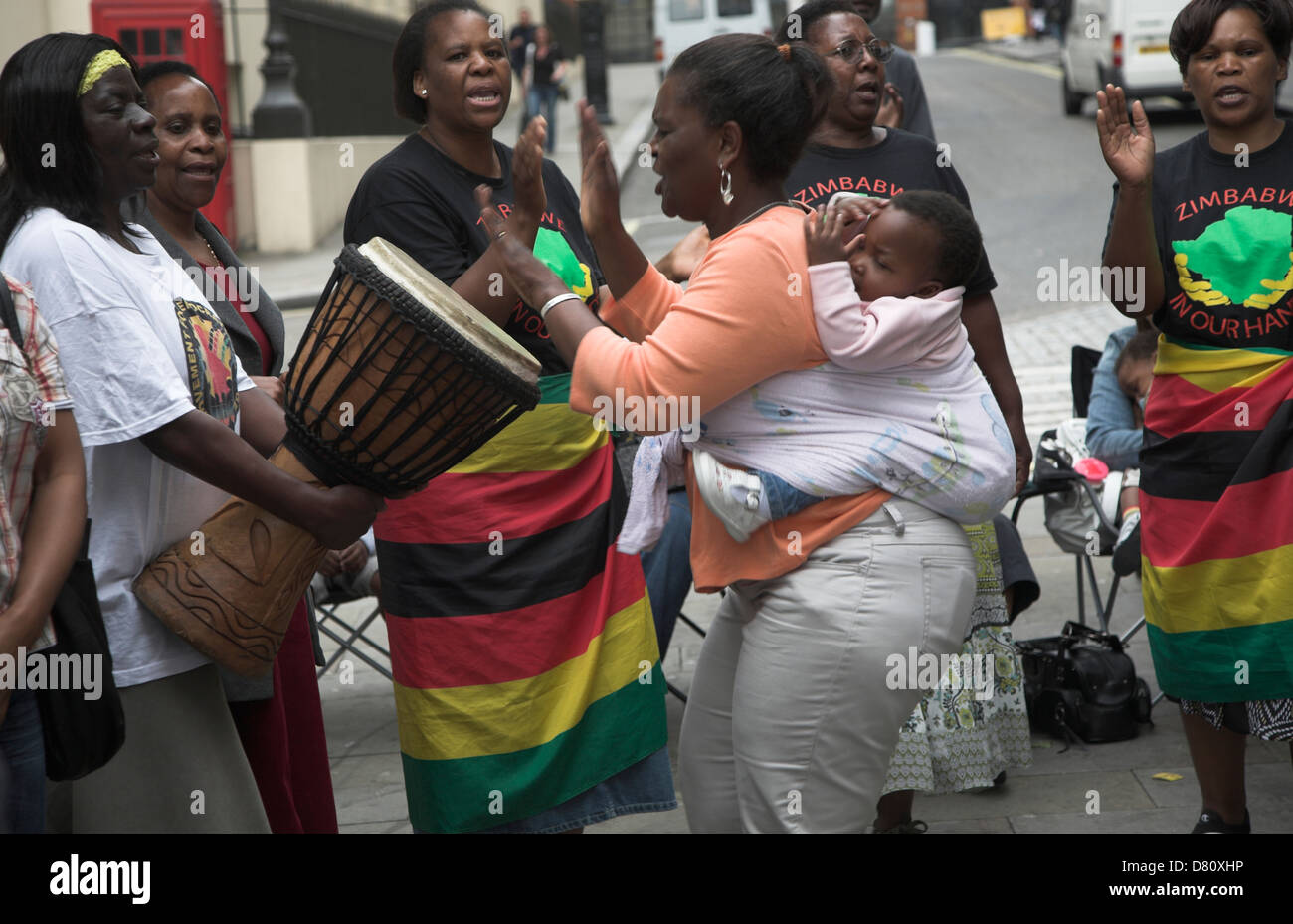 Rally in central London held by MDC every Saturday to protest against Robert Mugabe and his regime in Zimbabwe - Stock Image