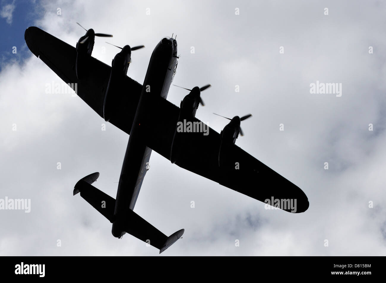16th of May 2013 Lancaster bomber, City of Lincoln KCA banking over Derwent reservoir on 70th Anniversary Dambusters - Stock Image
