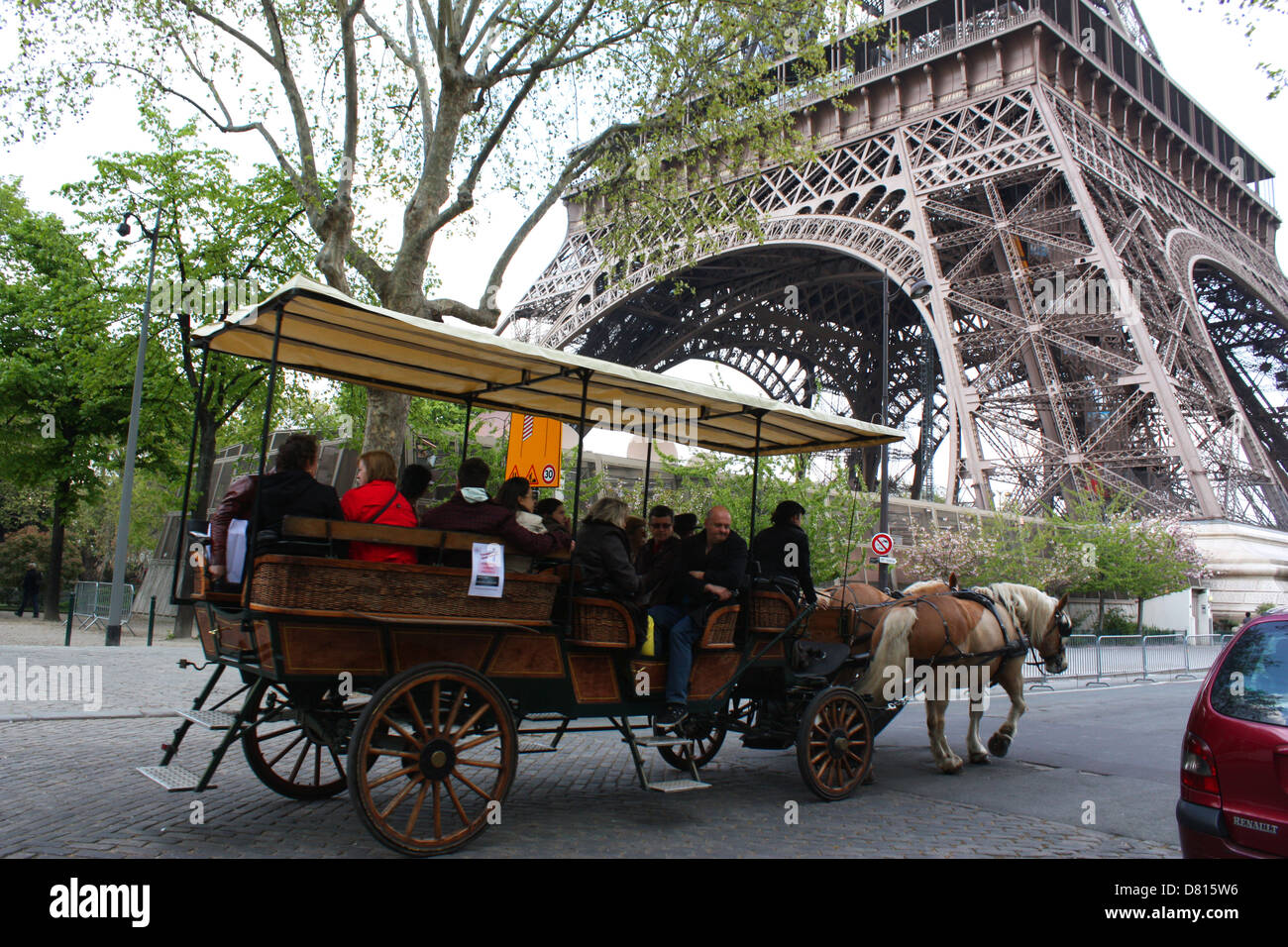 Horse chariot with passengers in front of Eiffel Tower, Paris, France Stock Photo