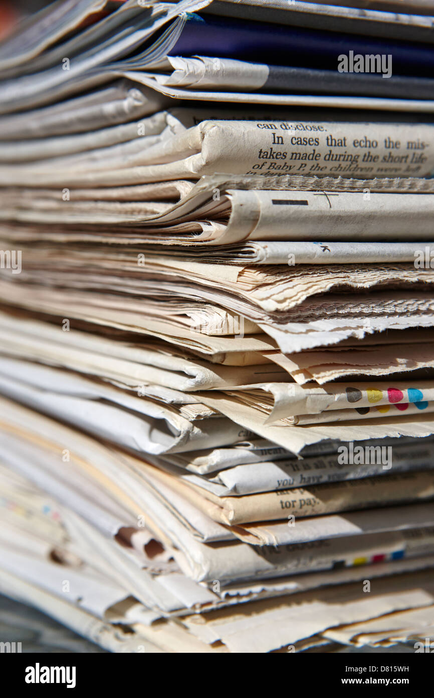 pile of old newspapers ready for recycling - Stock Image