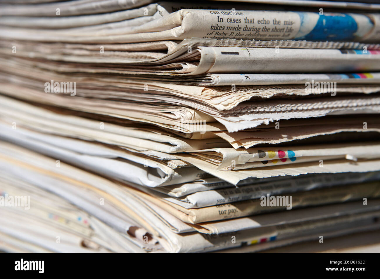 pile of old newspapers ready for recycling in the uk - Stock Image