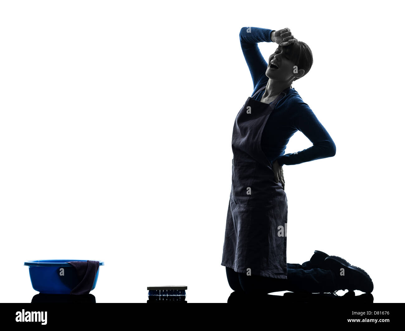 one woman maid cleaning backache washing floor in silhouette