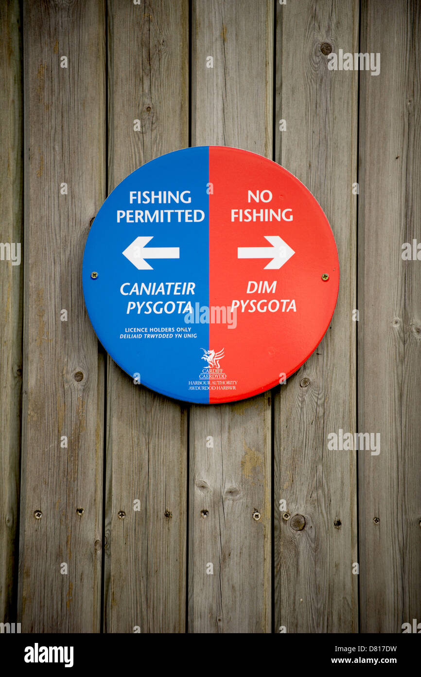 A sign on the Cardiff Bay barrage showing the area where fishing is permitted. - Stock Image