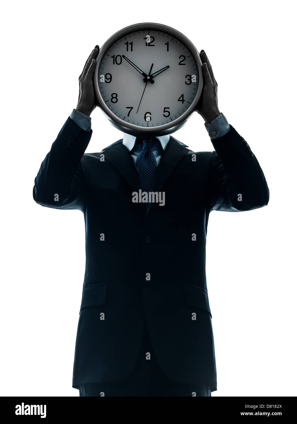 one  businessman holding clock in silhouette studio isolated on white background - Stock Image
