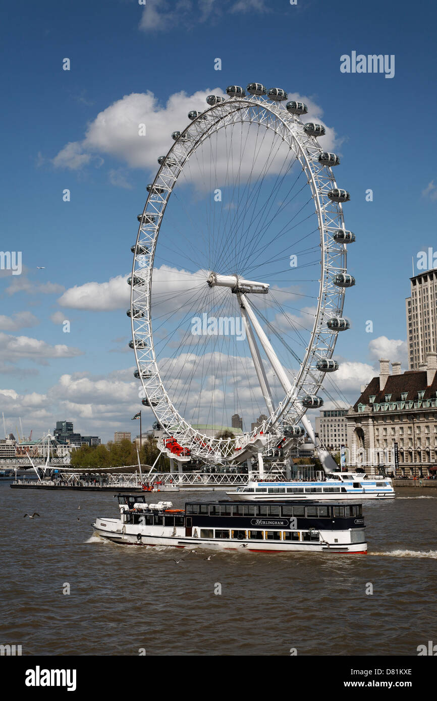 River Thames cruise boats, London Eye wheel from Westminster Bridge, London, England - Stock Image