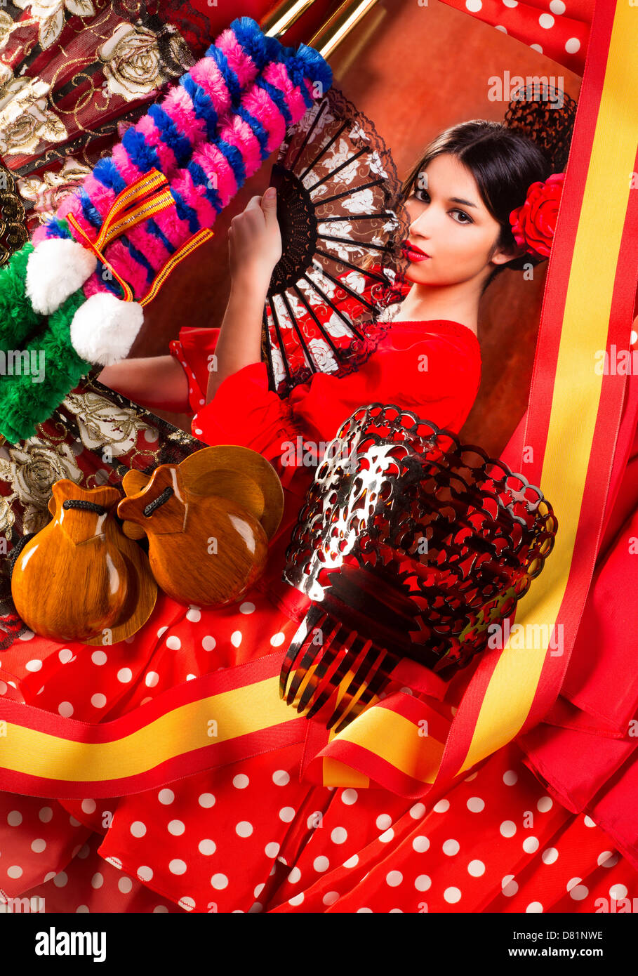 Flamenco woman with bullfighter and typical Spain Espana elements like castanets fan and comb - Stock Image