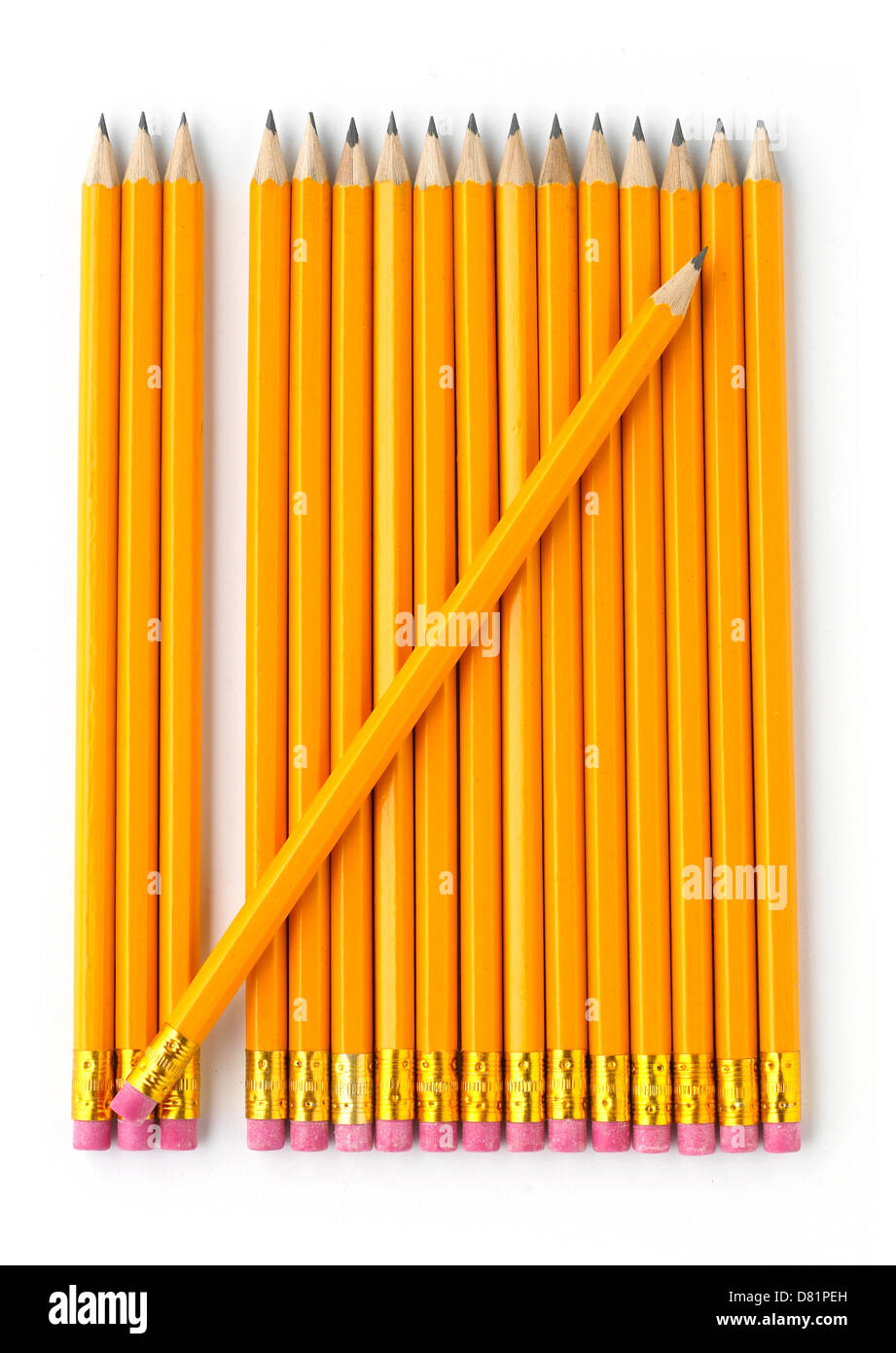 yellow pencils cut out onto a white background - Stock Image
