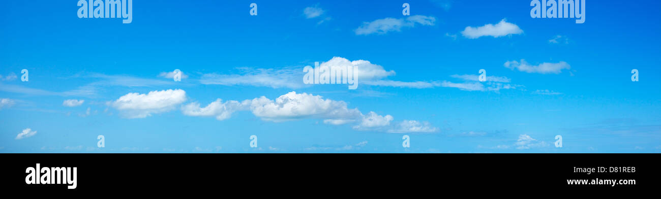 Blue sky with some white clouds. Panoramic shot. - Stock Image