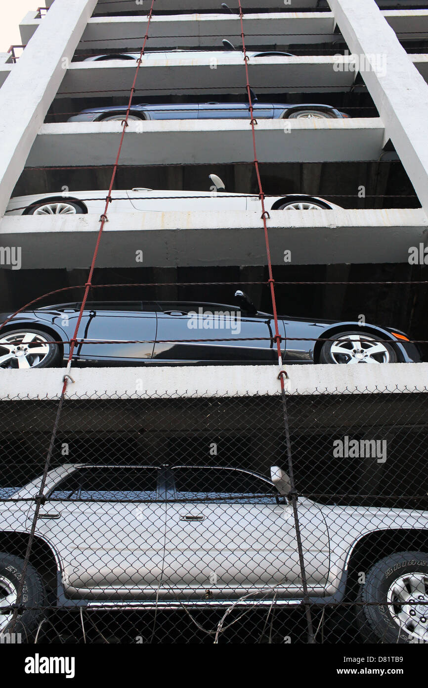 Staked cars in car park - Stock Image