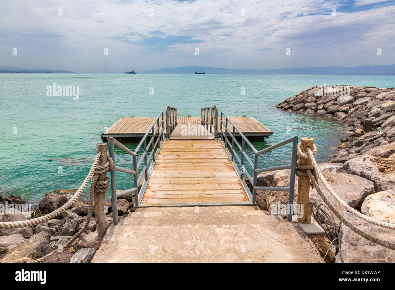 A wooden deck with metal railing on the shores of the Red sea - Stock Image