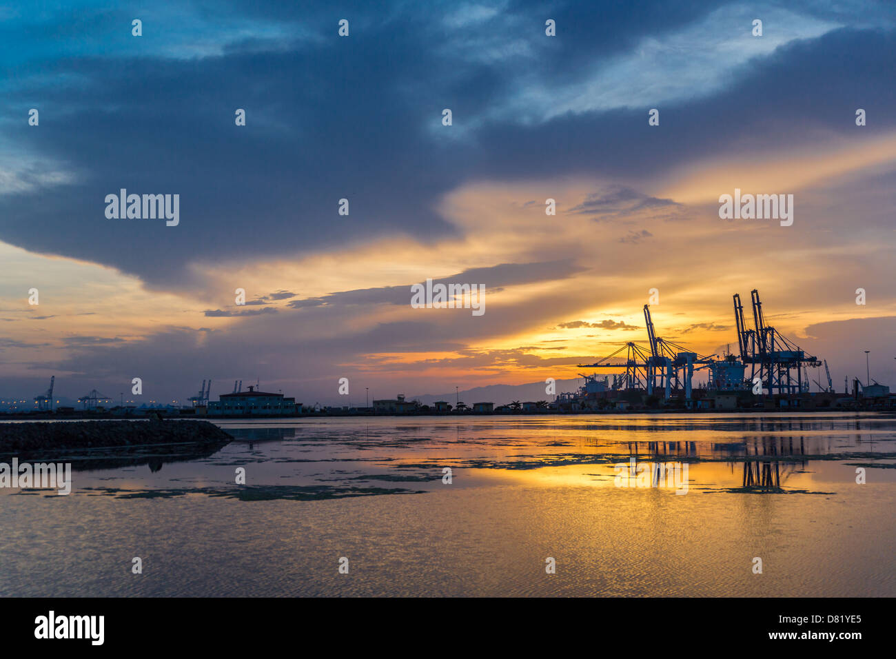 A beautiful sunset over the port of Djibouti on the Red sea - Stock Image