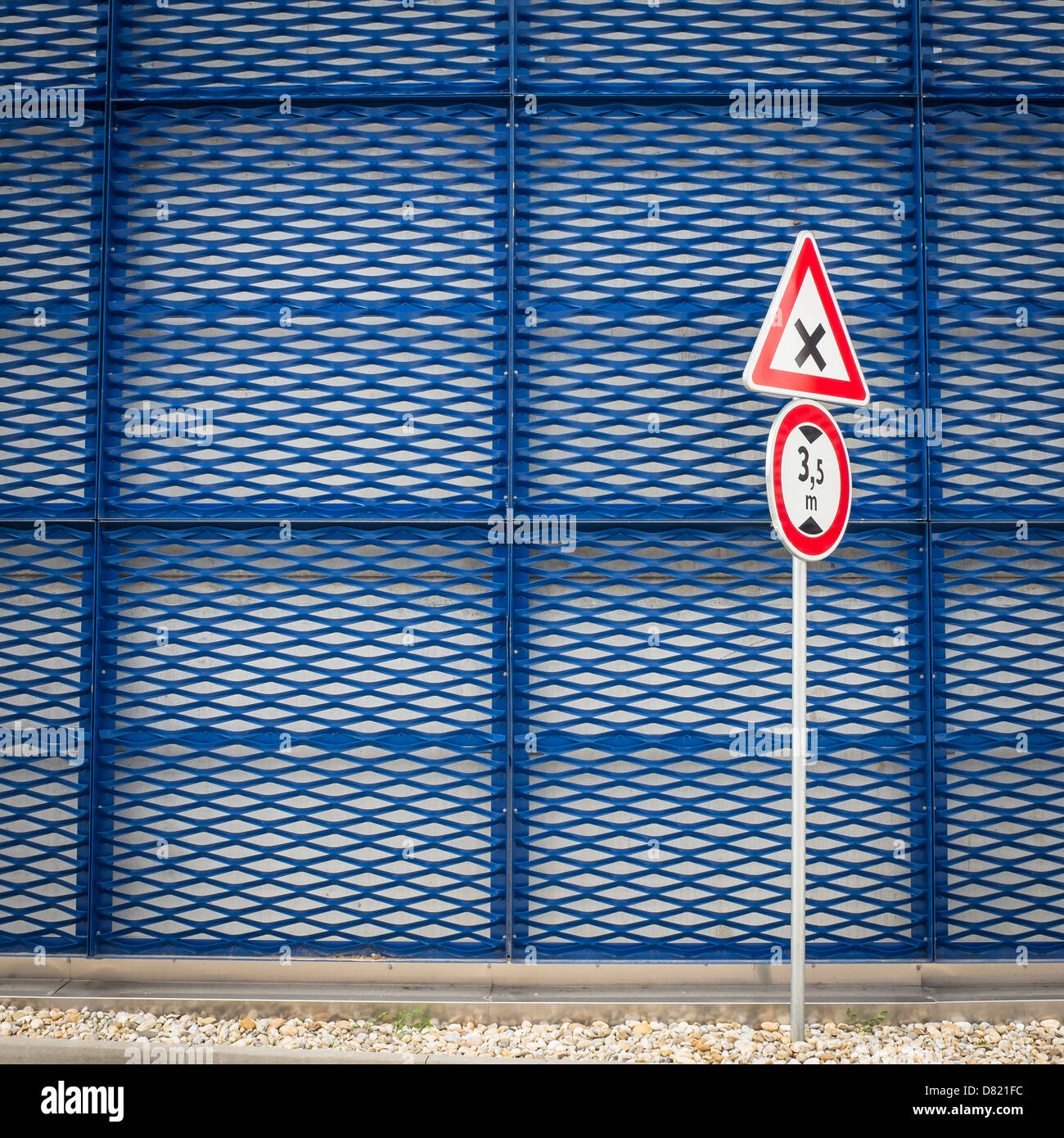 crossroad sign and blue metal facade - Stock Image