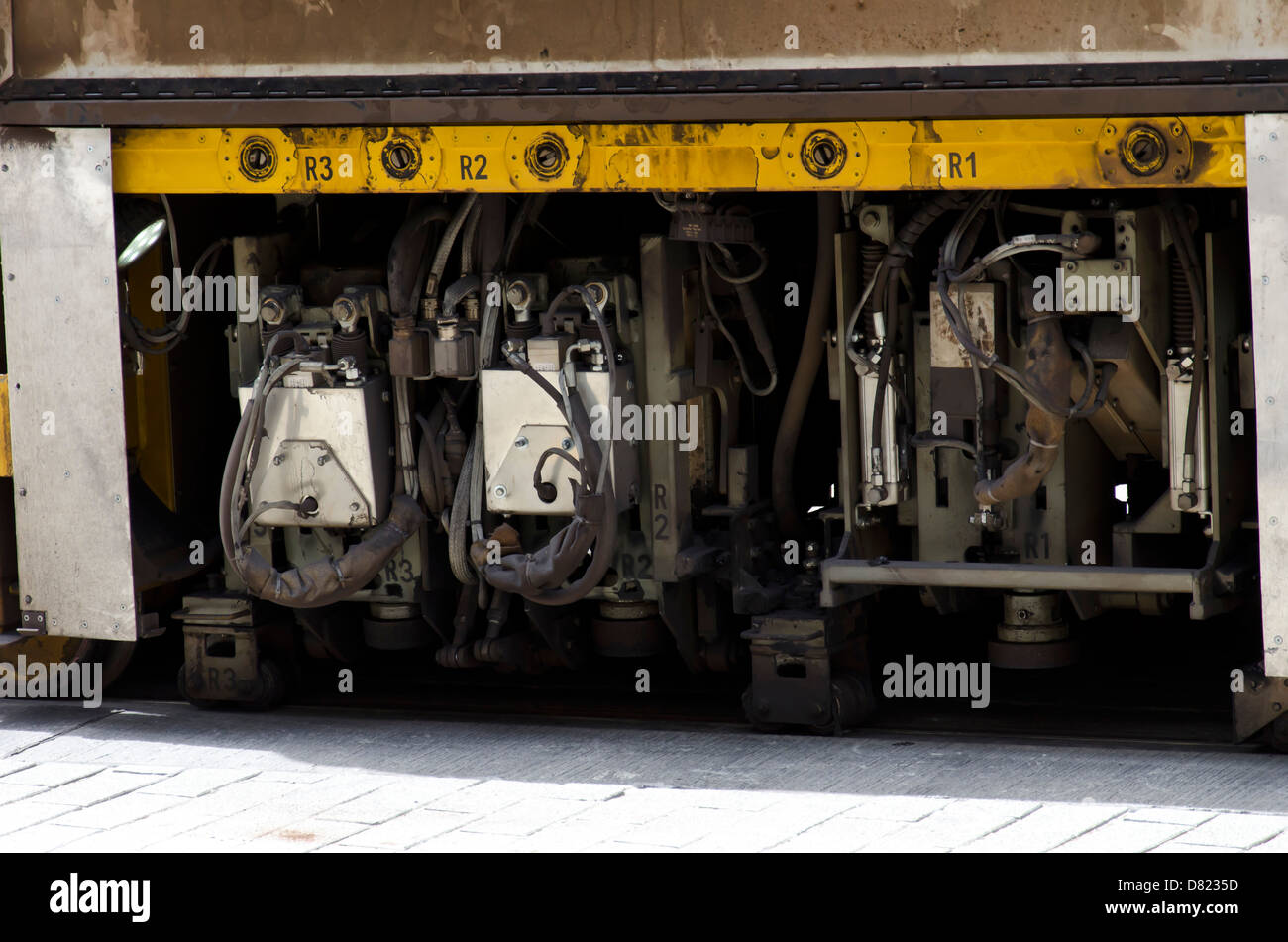 Track levelling and polishing for the controversial Edinburgh Tram project: The machine with the side-skirts removed. - Stock Image