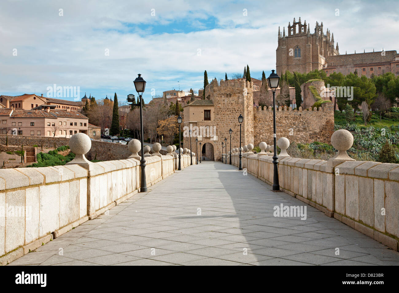 Toledo - Outlook form San Martin s bride or Puente de san Martin to Moanastery of saint John of the King in morning Stock Photo