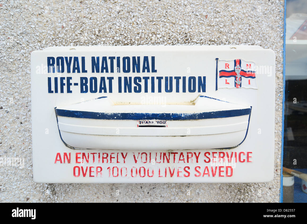 An donation box for the Royal National Lifeboat Institution (RNLI) in the UK. - Stock Image