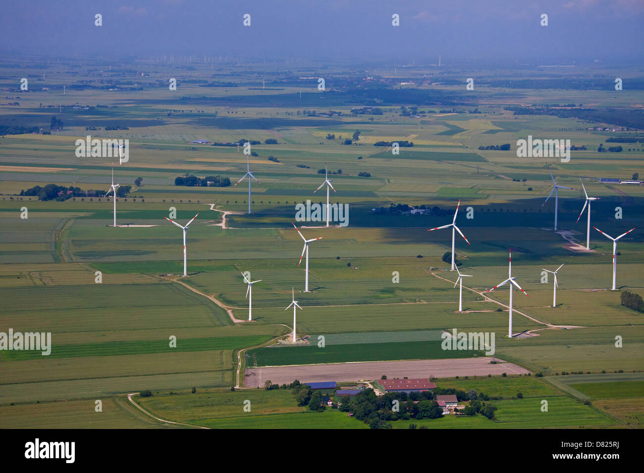 Aerial view over wind turbines at wind farm - Stock Image