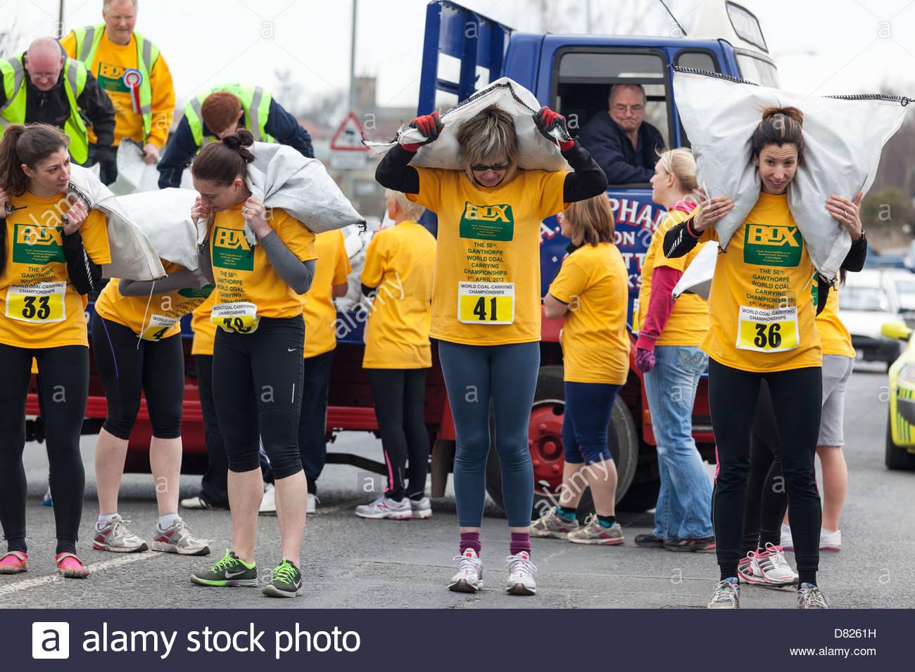 The World Coal Carrying Championships.  Women preparing to race Gawthorpe near Ossett West Yorkshire England - Stock Image