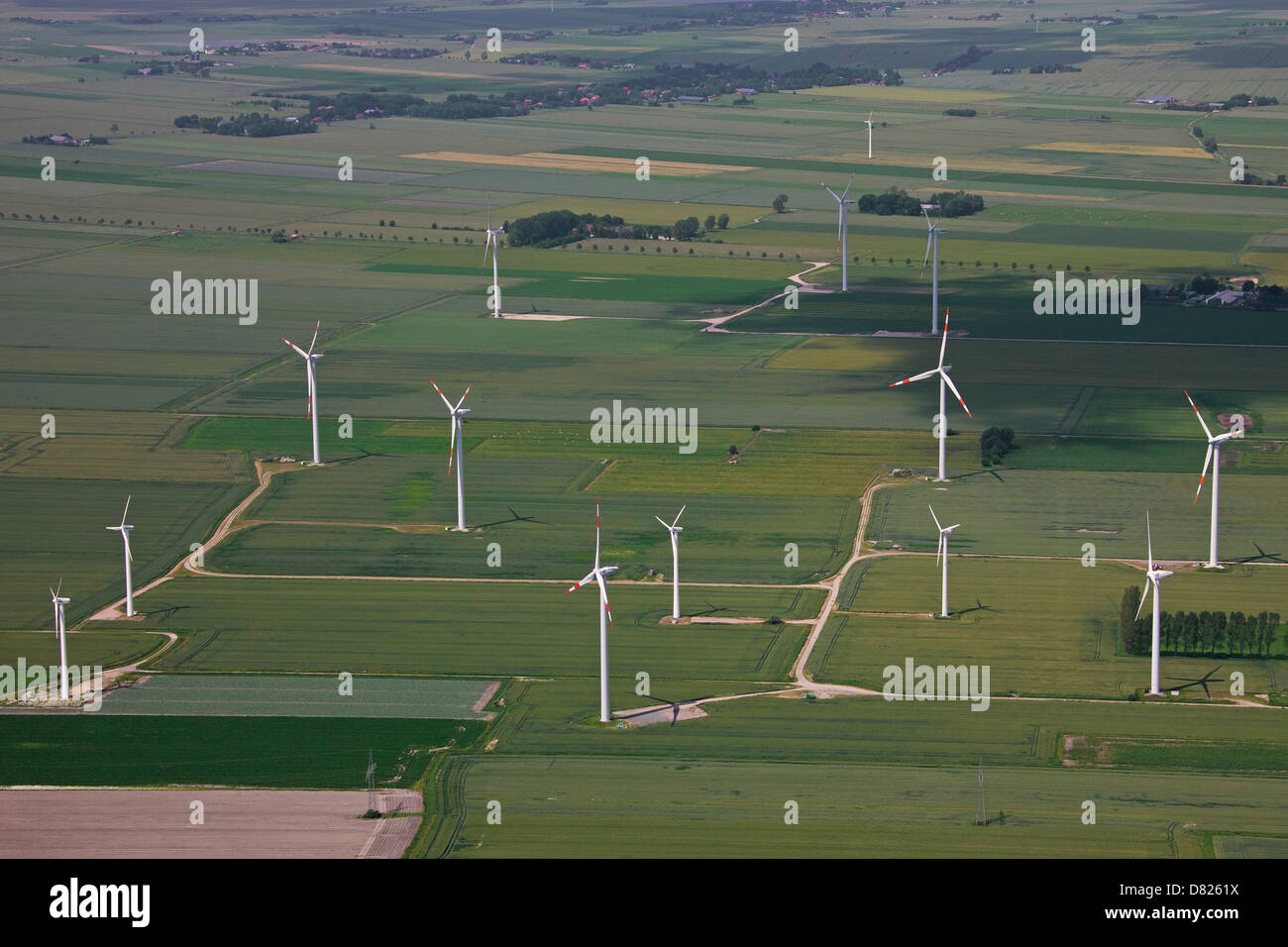 Aerial view over windturbines at wind farm - Stock Image