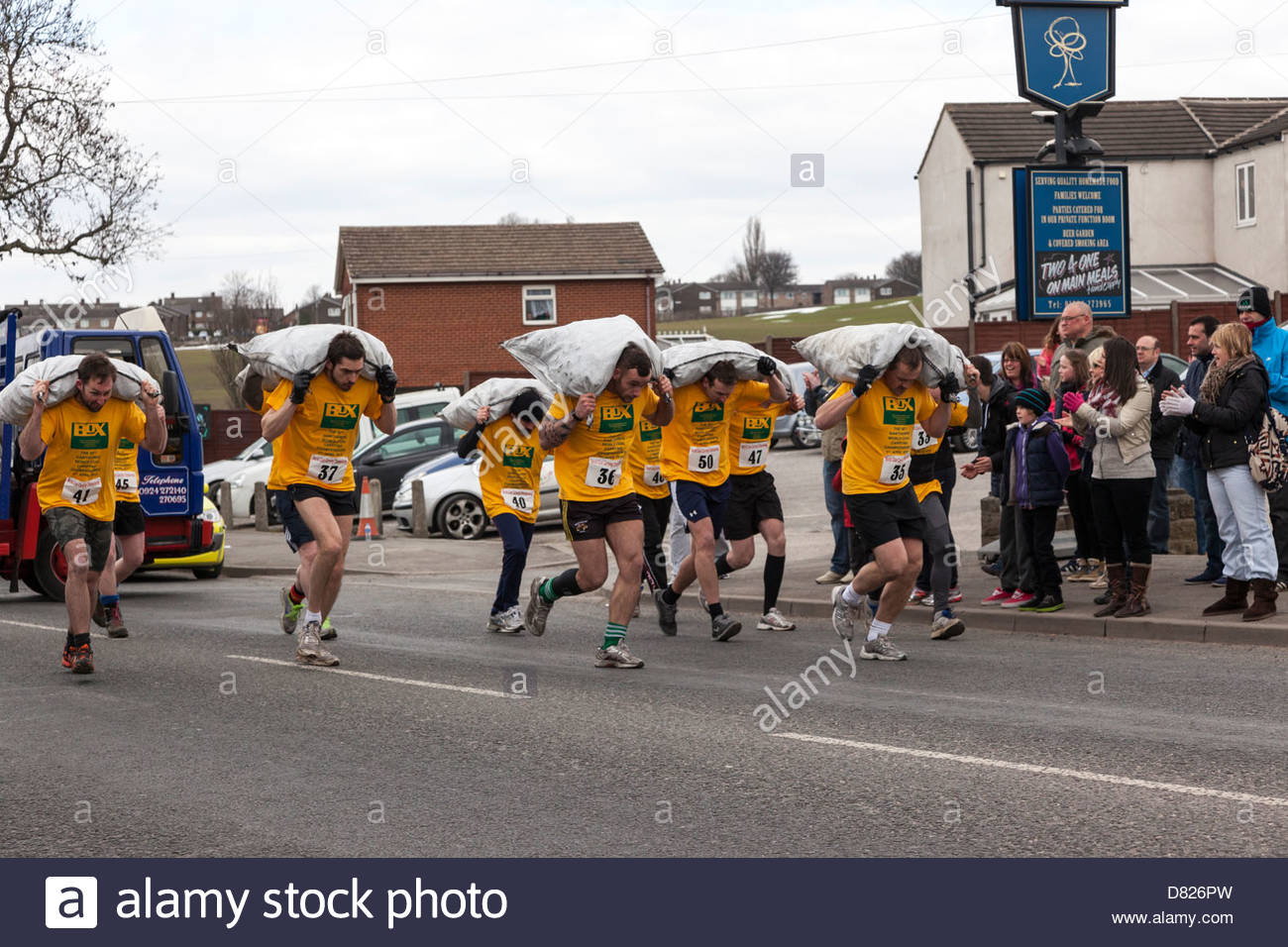 The World Coal Carrying Championships. Race start of one of the mens races . Gawthorpe West Yorkshire England - Stock Image