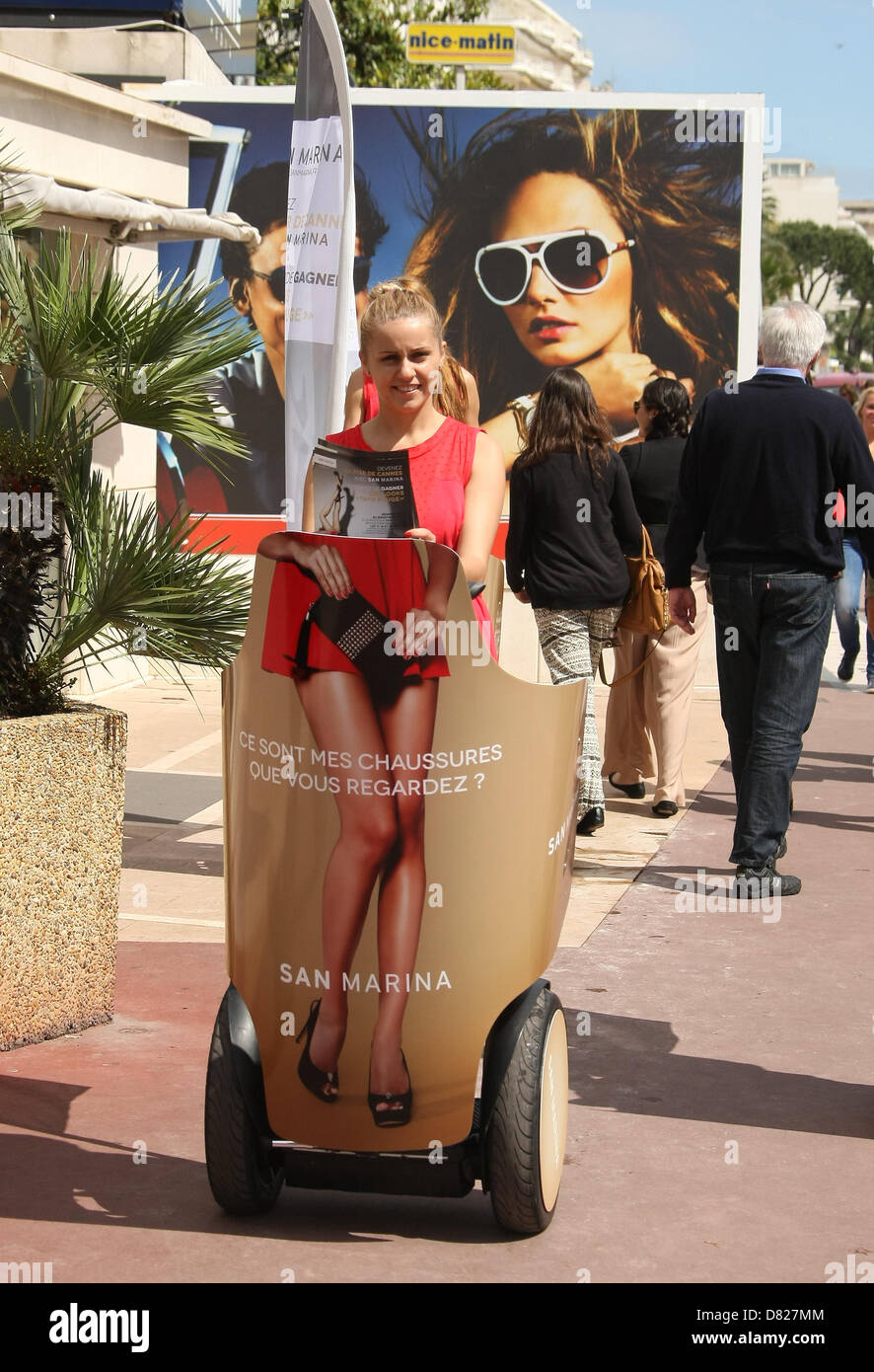 PROMOTIONAL WOMAN ON A SEGWAY MAGNUM. PHOTOCALL. CANNES FILM FESTIVAL 2013 CANNES  FRANCE 17 May 2013 - Stock Image