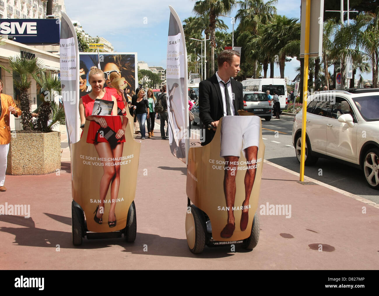 PROMOTIONAL COUPLE ON A SEGWAY MAGNUM. PHOTOCALL. CANNES FILM FESTIVAL 2013 CANNES  FRANCE 17 May 2013 - Stock Image