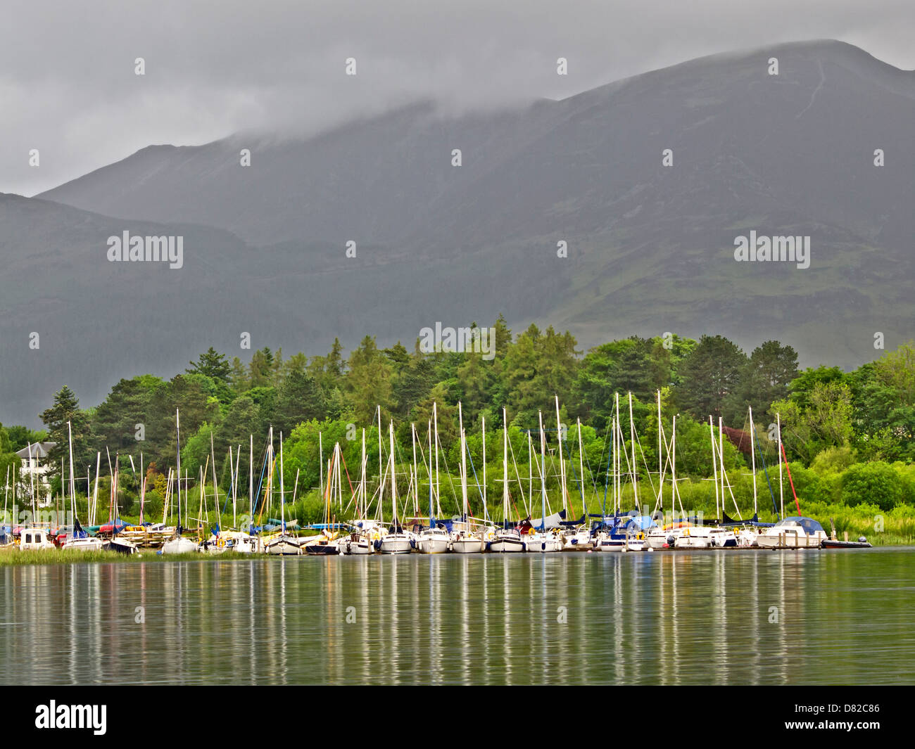 Lake and Boats with mountains on the background at Nicol End Broads, Lake District , Cumbria, UK - Stock Image