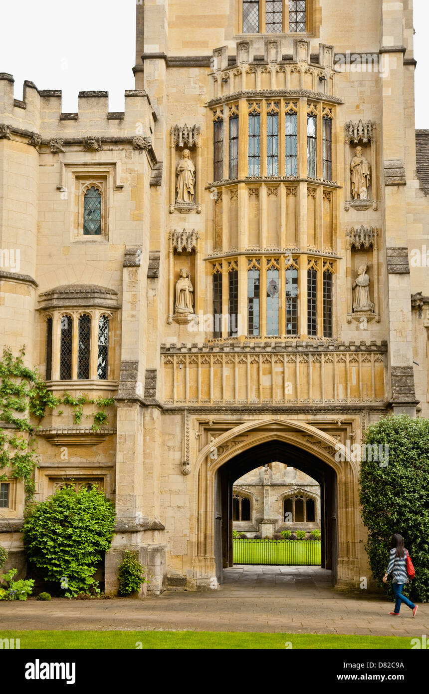 Founders Tower, Magdalen College Oxford. A young woman approaches the archway leading into the cloister gardens. - Stock Image
