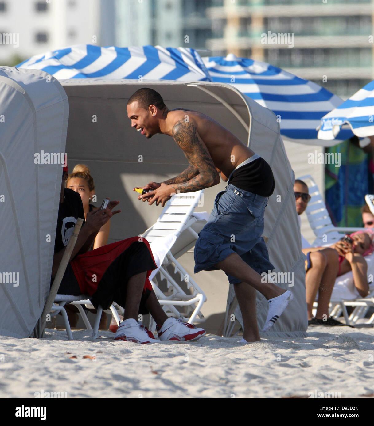 Chris Brown Jokes Around With Friends On Miami Beach Miami Florida