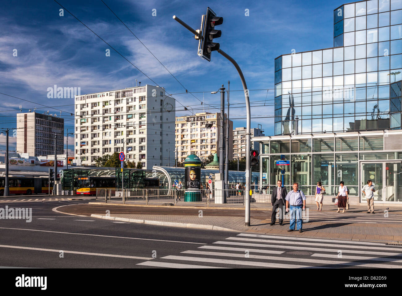 Typical Eastern European city centre summer street scene at Plac Bankowy (Bank Square) in Warsaw, Poland. - Stock Image