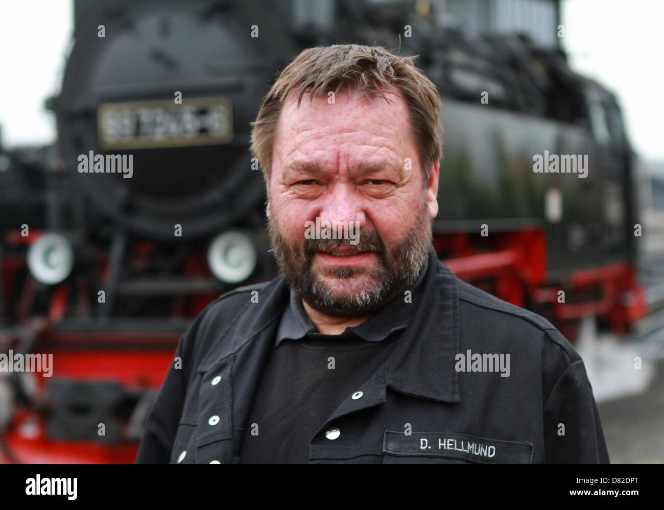Engineer Dieter Hellmund sits in the driver's seat in steam locomotive from the Harz Narrow Gauge Railway (HSB) - Stock Image