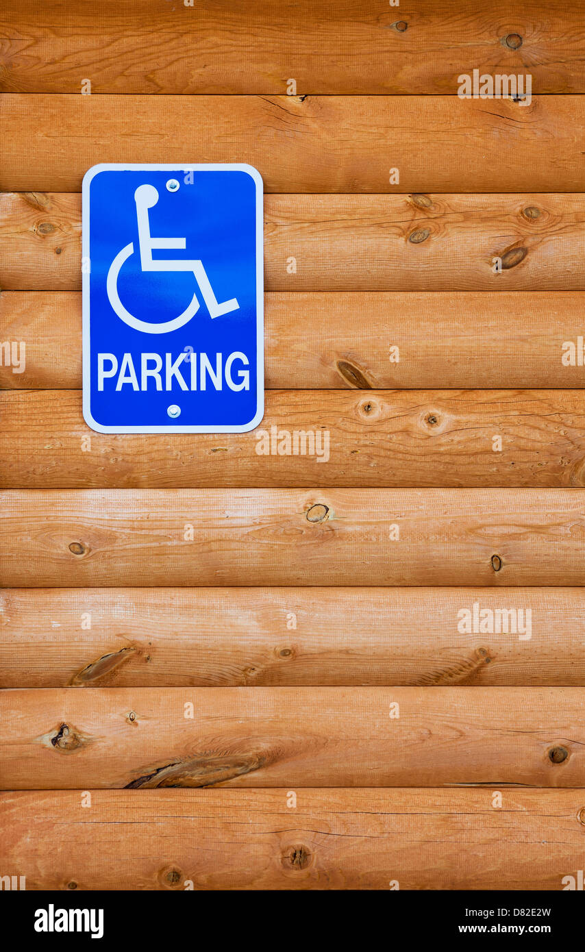 Traditional handicapped parking sign for the disabled on a wooden wall, Utah - Stock Image