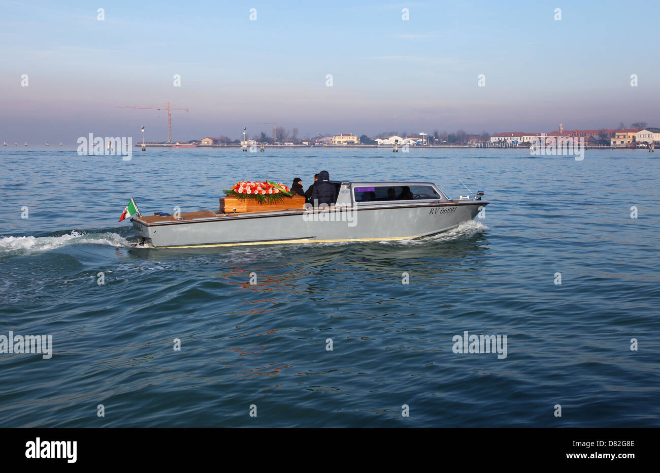 A coffin being carried by a boat on it's way to the cemetery on San Michele island Venice Italy - Stock Image