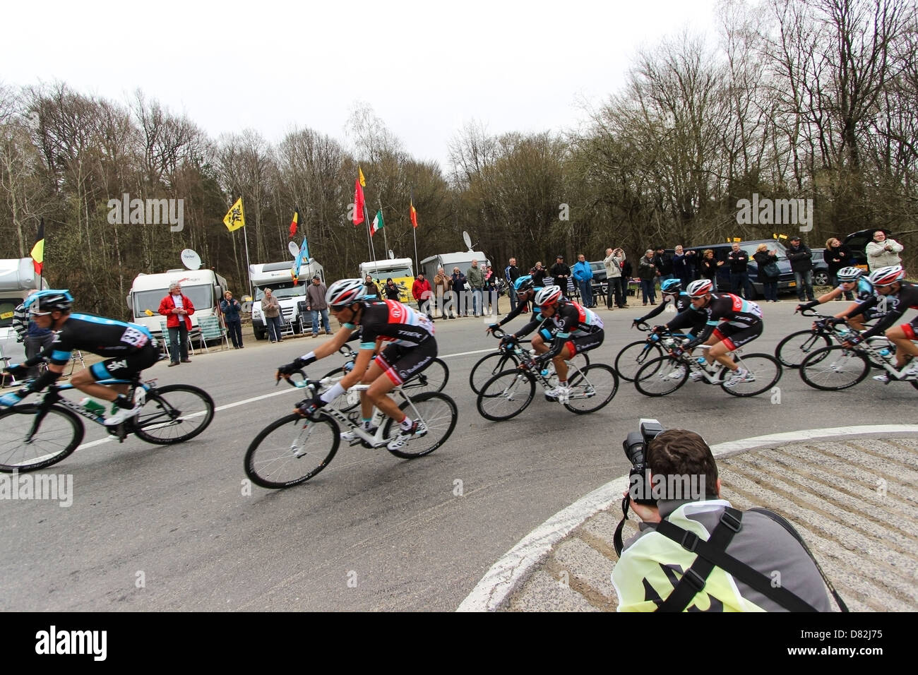 Professional sport photographers at work on a cycling race - Stock Image