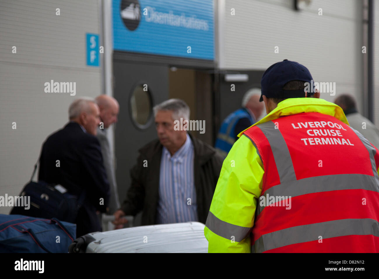 Liverpool, UK 17th May, 2013. Loading suitcases at Cruise Liner Terminal where the Passenger ship registered in - Stock Image
