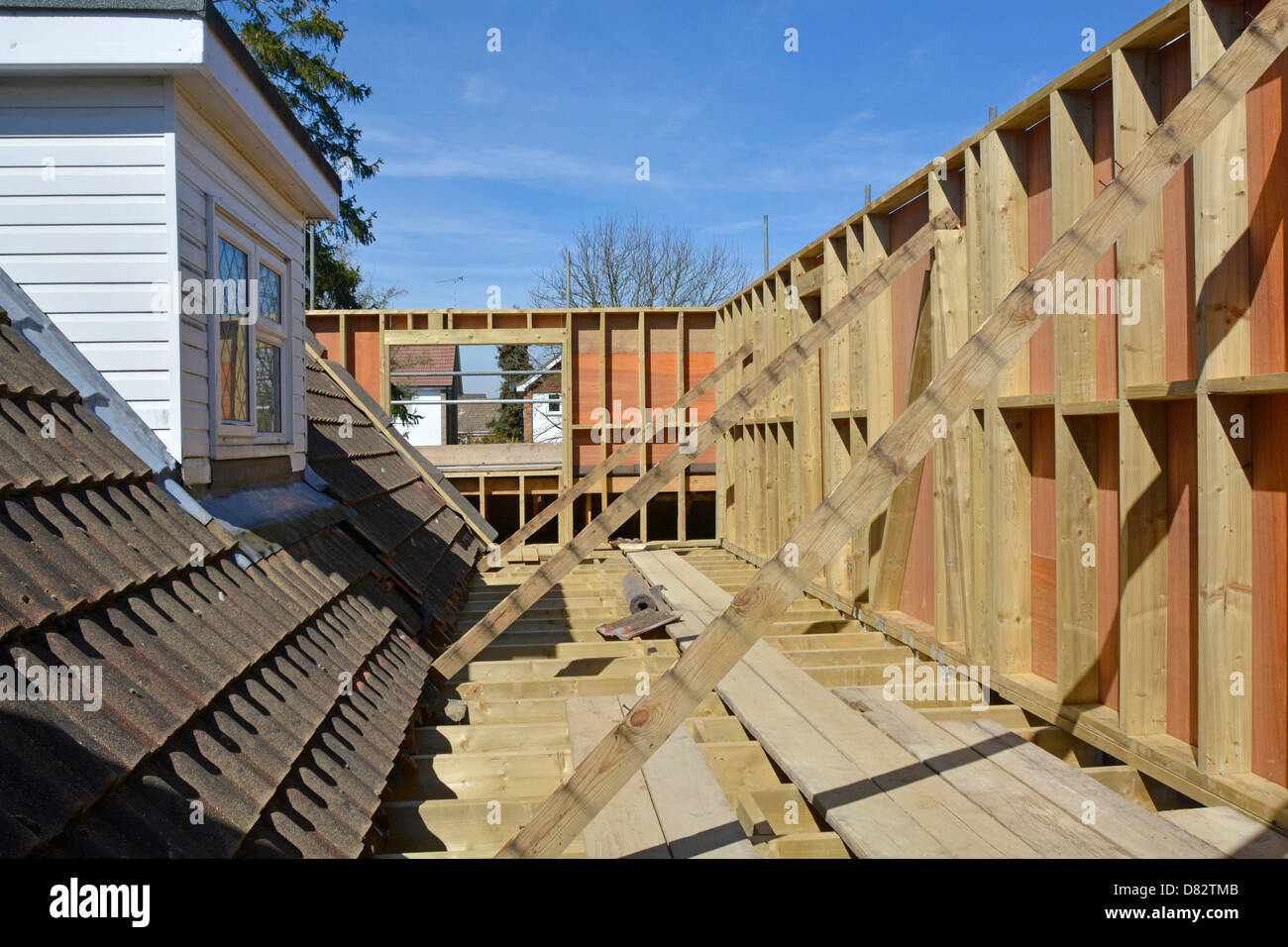 Detached house new bedroom extension first floor joist & timber frame plywood panels await new roof England - Stock Image