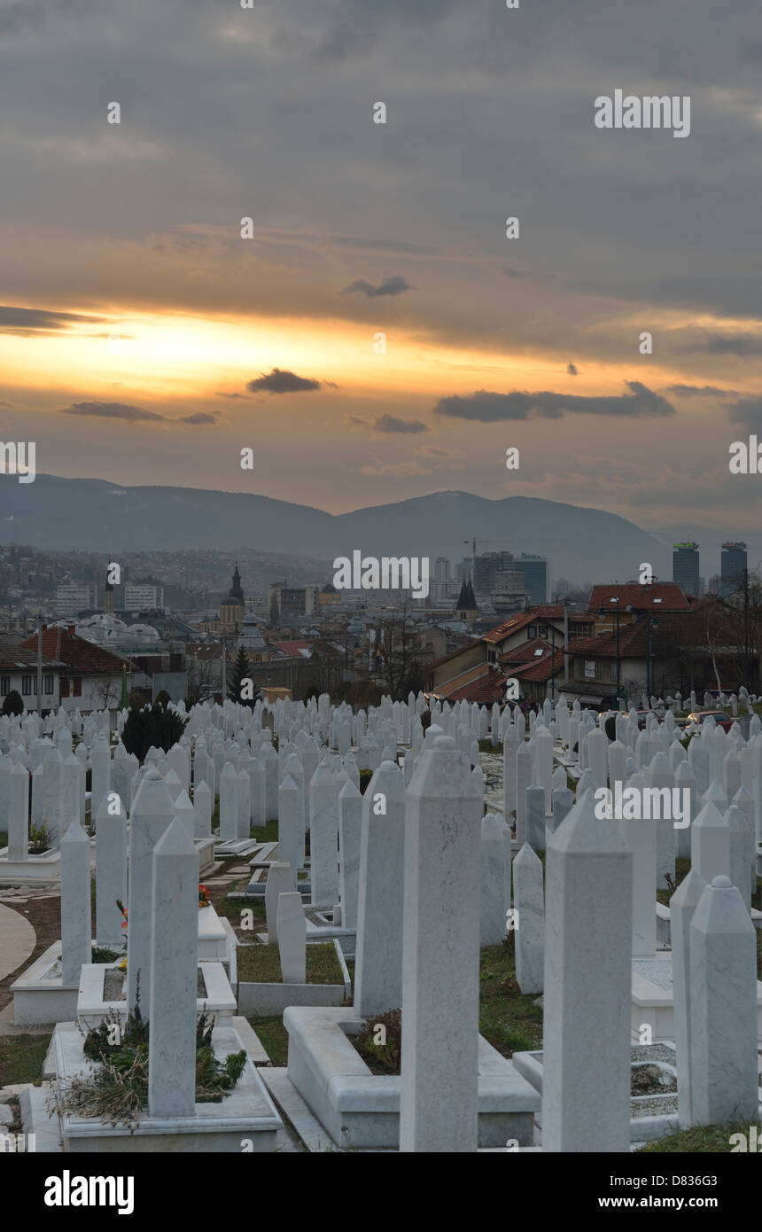 Graves of civil war victims in Martyrs' Memorial Cemetery Kovaci with Alija Izetbegovic tomb, Sarajevo, Bosnia - Stock Image