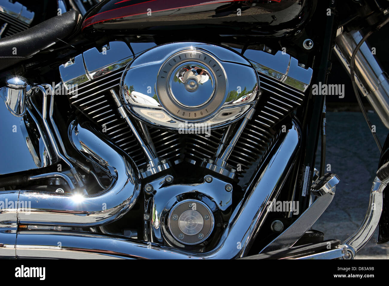 Harley Davidson Stock: A Harley Davidson Fatboy Chrome Motor Stock Photo