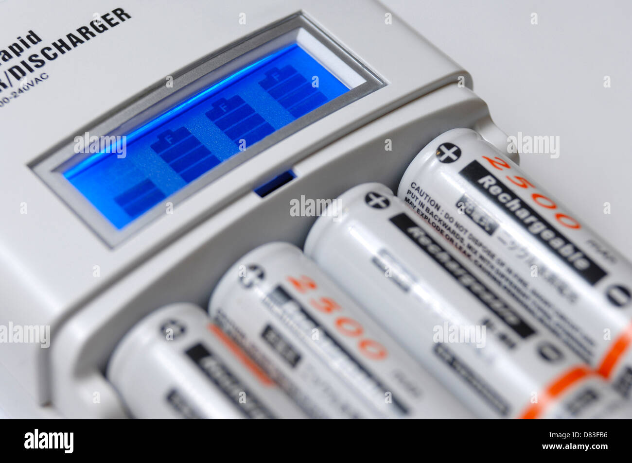 Smart Rapid AA Battery Charger With LCD Showing The Charge Level And Four Rechargeable NiMh Batteries