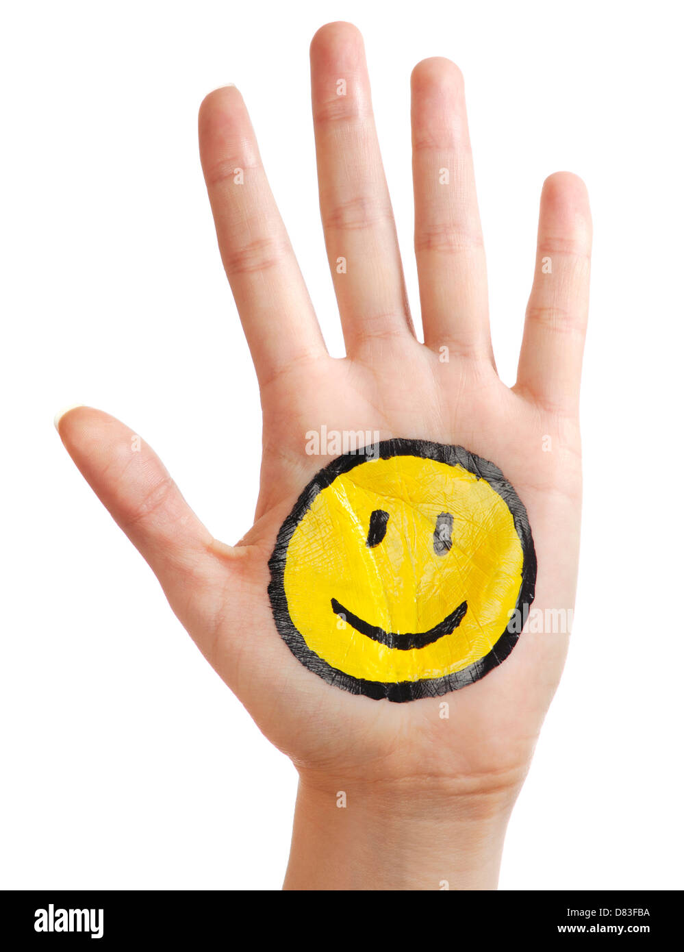 Open hand with a happy smiling smiley icon painted on it isolated on white background Stock Photo