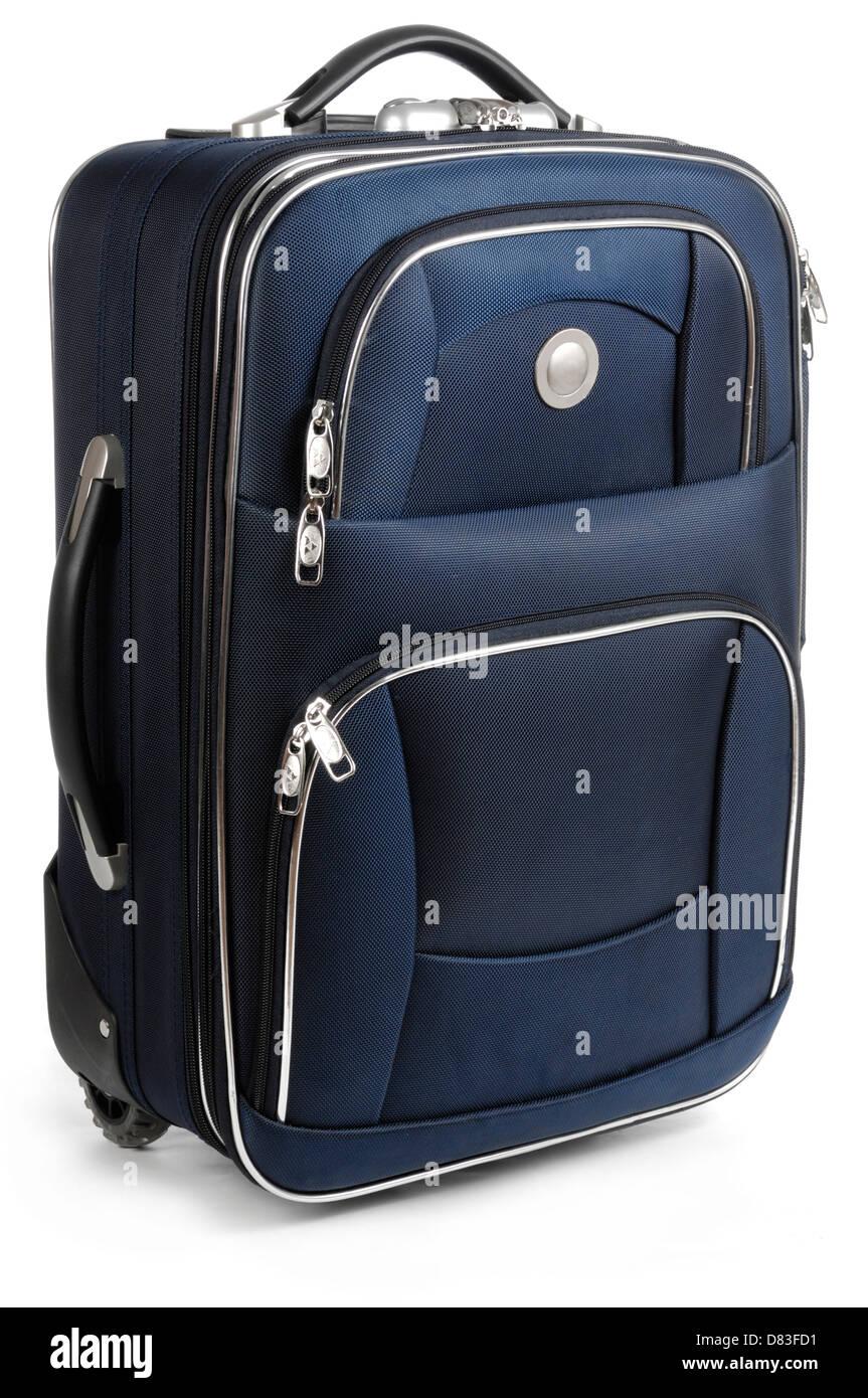Large blue travel suitcase Isolated on white background - Stock Image