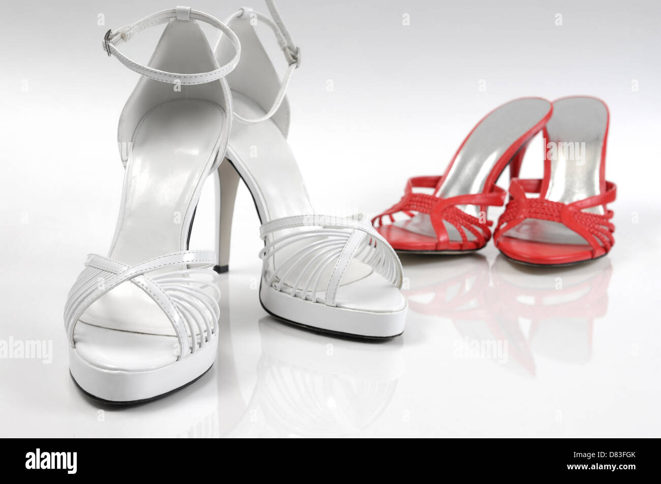 White and red high heel women shoes closeup isolated on white background - Stock Image