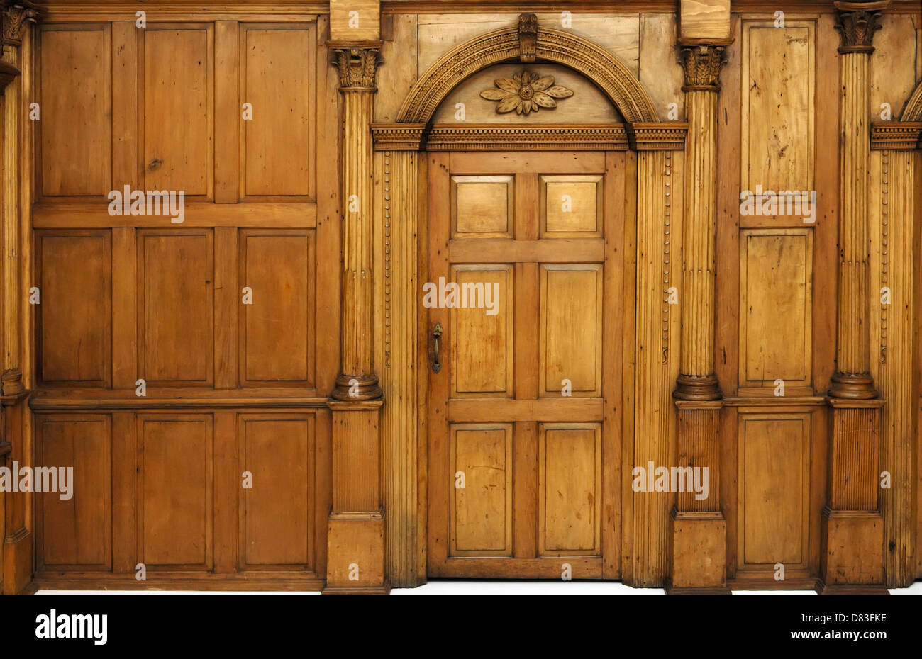 Gentil Wooden Paneled Wall And An Arched Door Victorian Architecture Style Interior    Stock Image