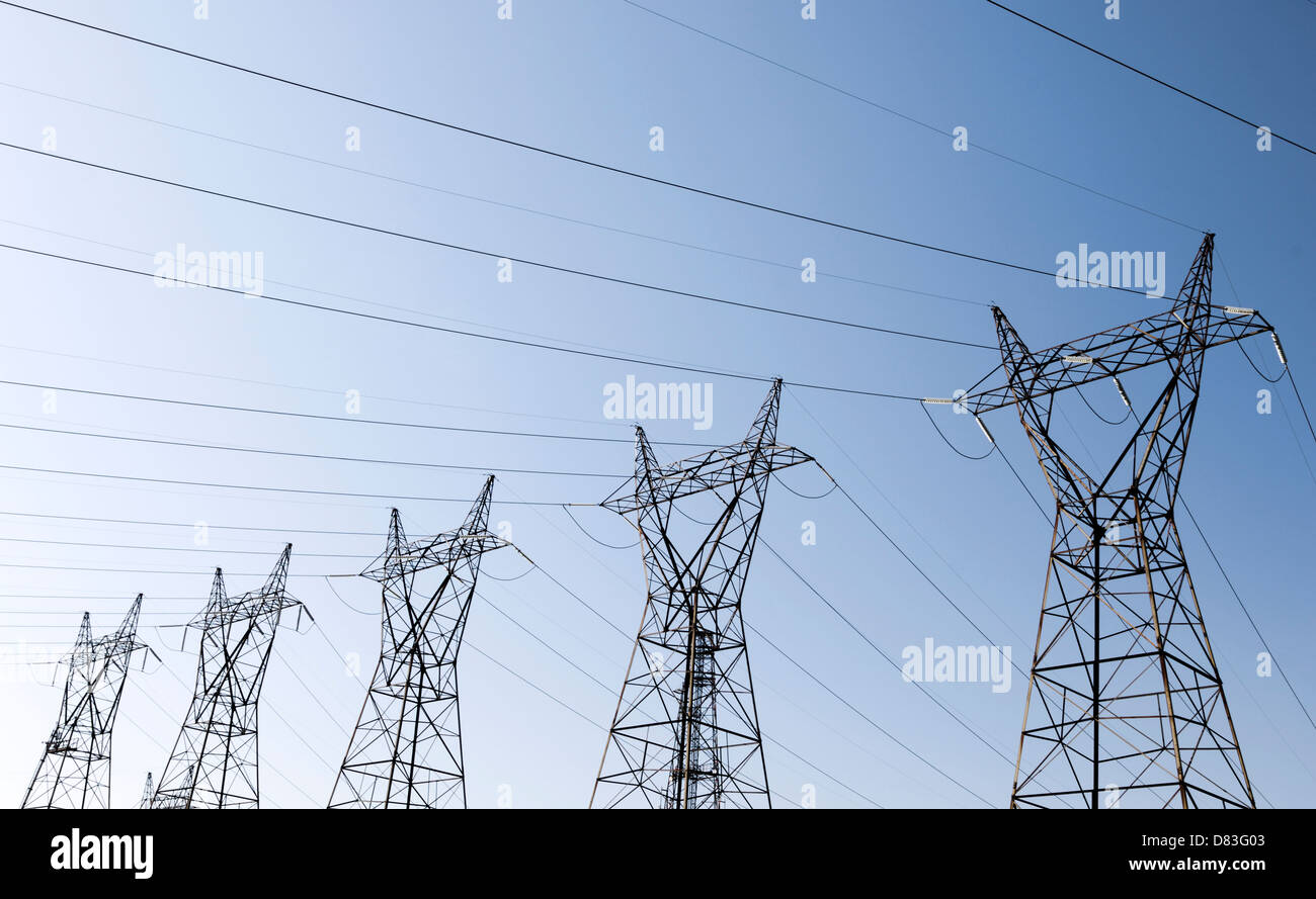 Power lines over blue sky background. Ontario, Canada. - Stock Image